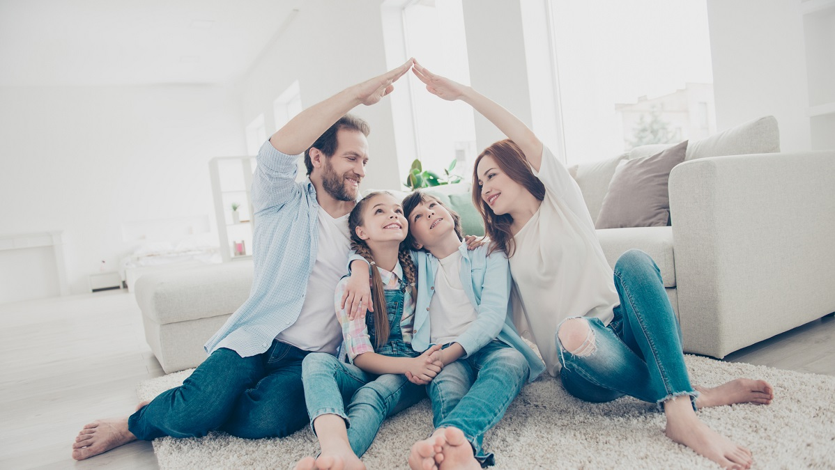 Family in home representing insurance with a roof over their heads