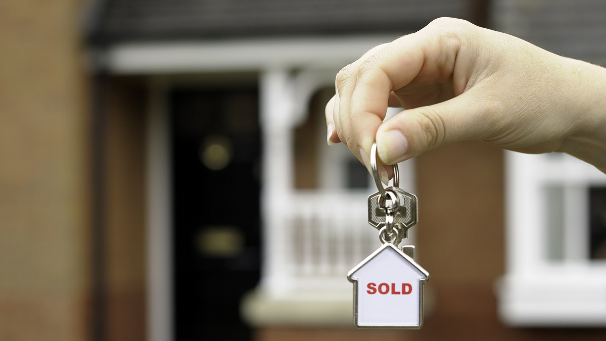 person with keys to house after closing USDA loan