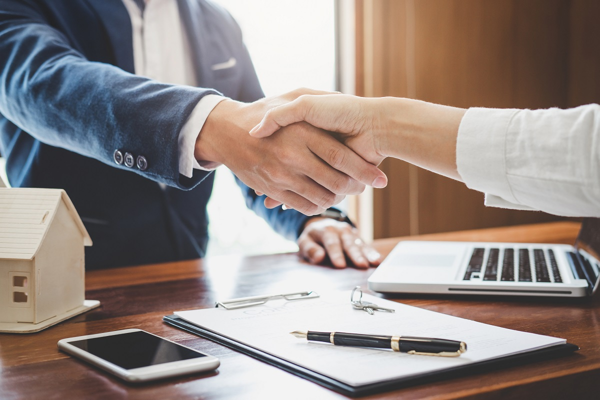 person shaking hand with their lender